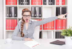 Angry business woman boss pointing out. Dismissal concept. Angry business woman boss pointing out in office. Dismissal concept Royalty Free Stock Photo