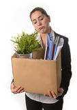 Angry Business Woman carrying Cardboard Box fired from Job Royalty Free Stock Image