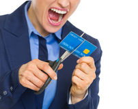 Angry business woman cutting credit card with scissors Royalty Free Stock Photos