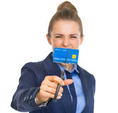 Angry business woman cutting credit card with scissors Royalty Free Stock Images
