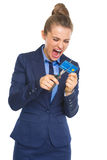 Angry business woman cutting credit card with scissors Royalty Free Stock Photo