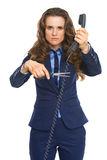 Angry business woman cutting phone wire Royalty Free Stock Images