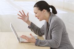 Angry business woman with her laptop Royalty Free Stock Photo