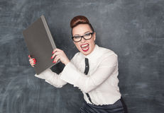 Angry business woman with laptop Stock Image
