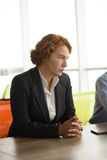 Angry business woman in office stock photo
