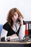 Angry business woman on the phone Royalty Free Stock Images