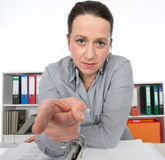 Angry business woman. Is pointing in to the camera royalty free stock photo