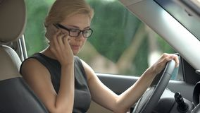 Angry business woman quarreling with husband on smartphone in car, stress stock images