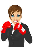 Angry business woman ready to fight with boxing gloves. Over white background Stock Image