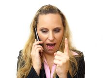 Angry business woman screaming in her cell phone Stock Photos
