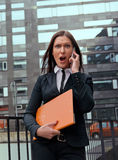 Angry business woman screaming in her phone Stock Photo