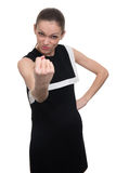 Angry business woman shakes her fist Stock Photography
