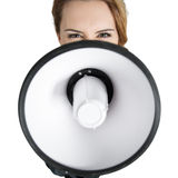 Angry  business woman shouting with a megaphone Stock Image