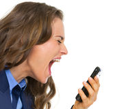 Angry business woman shouting in mobile phone Royalty Free Stock Images