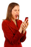 Angry business woman shouting at the phone Royalty Free Stock Photography