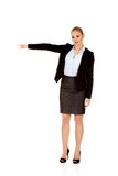 Angry business woman shows get out gesture Royalty Free Stock Images