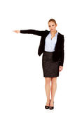 Angry business woman shows get out gesture Royalty Free Stock Photo