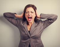 Angry business woman in suit strong screaming with wild open mou Stock Photography