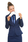 Angry business woman tearing documents Stock Photo