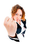 Angry business woman threatened by fist. Wide angle top view humorous portrait Stock Image