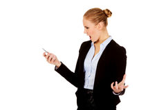 Angry business woman yelling to the mobile phone Stock Image