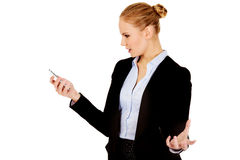 Angry business woman yelling to the mobile phone Stock Photos