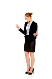 Angry business woman yelling to the mobile phone Royalty Free Stock Images