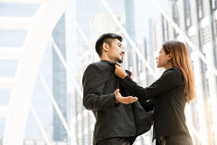 Angry business women shouting to a colleague with Snatch a collar. Royalty Free Stock Photography