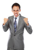 Angry businessman. Portrait of asian angry businessman ready to fight Royalty Free Stock Photo