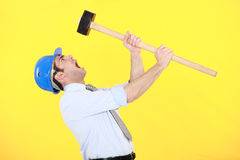 Angry businessman. Holding a hammer Royalty Free Stock Photography
