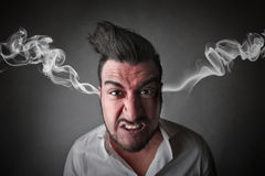 Angry businessman. With smoke coming out from his ears Royalty Free Stock Images