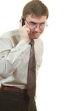 Angry businessman. Young businessman is angry. Talking via phone Royalty Free Stock Photography