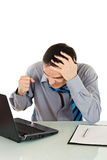 Angry businessman. Shows his frustration while working on the laptop - isolated Royalty Free Stock Photography