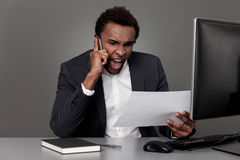 Angry businessman from Africa Stock Image