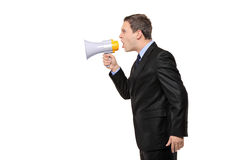 Angry businessman announcing via megaphone Royalty Free Stock Photo