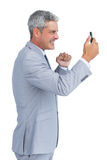 Angry businessman answering phone Royalty Free Stock Images