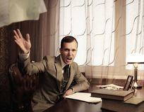 Angry businessman behind table Royalty Free Stock Photos