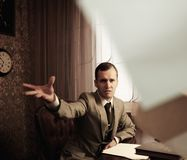 Angry businessman behind table Royalty Free Stock Photo