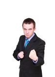 Angry businessman in boxer position. Isolated Stock Photo