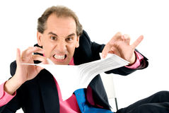 Angry businessman breaking contract. Angry businessman breaking contract on white background Royalty Free Stock Image