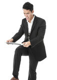 Angry businessman breaking a laptop Royalty Free Stock Images