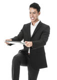 Angry businessman breaking a laptop. Angry businessman trying to break his laptop Stock Photography