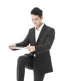 Angry businessman breaking a laptop. Angry businessman trying to break his laptop Stock Photos