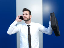 Angry businessman at the cell phone. Angry businessman talking on the cell phone Stock Images