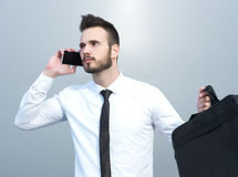 Angry businessman at the cell phone. Angry businessman talking on the cell phone Royalty Free Stock Photo