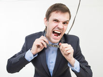 Angry businessman on the chain with a collar Royalty Free Stock Image