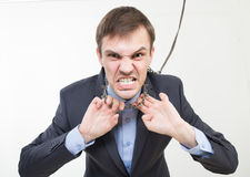 Angry businessman on the chain with a collar Stock Photo