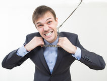 Angry businessman on the chain with a collar Stock Photos