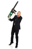 Angry businessman with chainsaw Royalty Free Stock Images