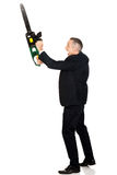 Angry businessman with chainsaw. Furious mature businessman with chainsaw royalty free stock photos